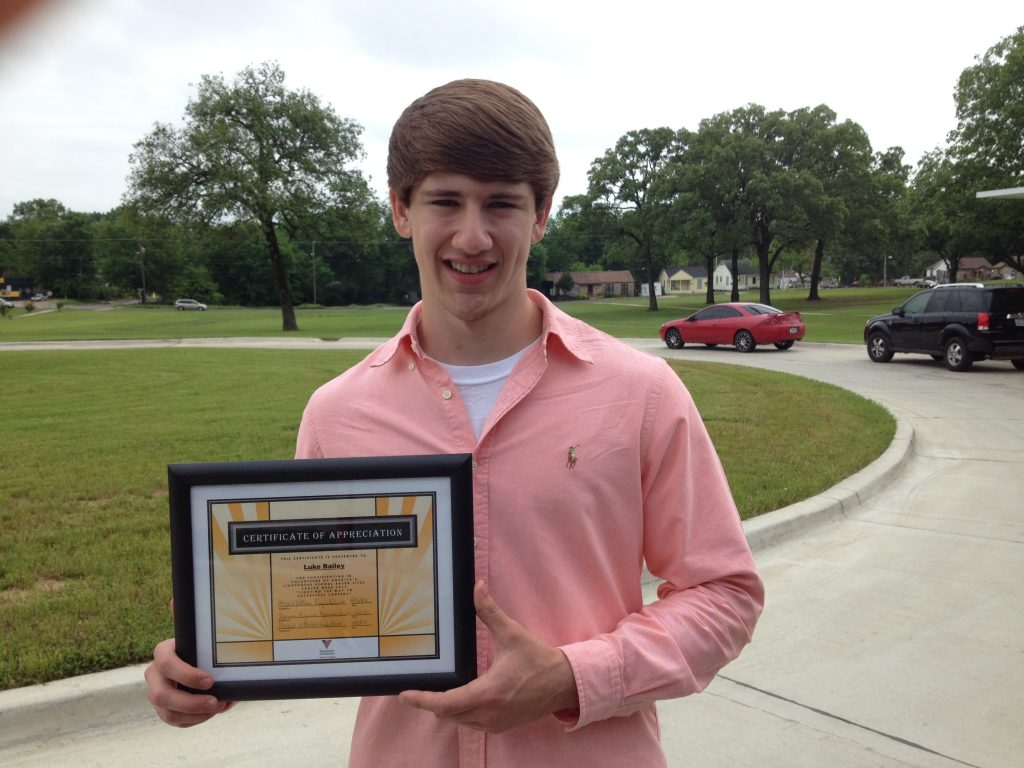 luke baily with certificate